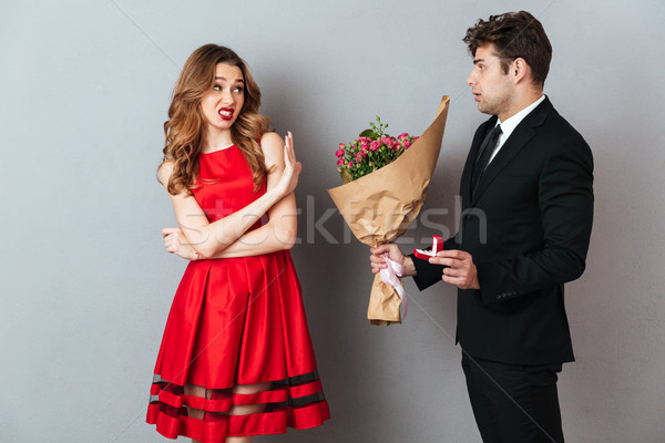 Portrait of a man proposing to a girl with flowers Stock photo © deandrobot