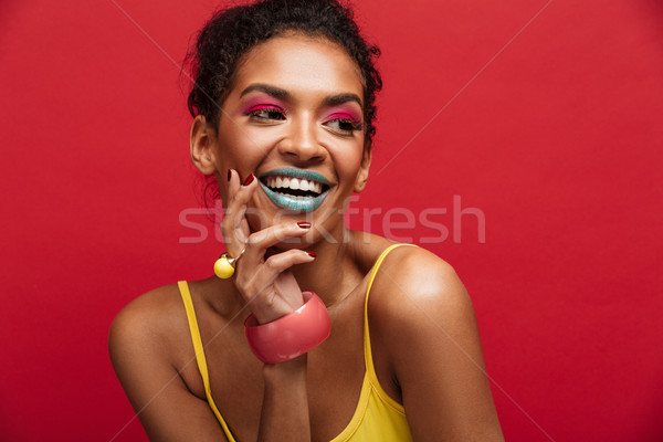 Beautiful portrait of happy african american female model in yel Stock photo © deandrobot