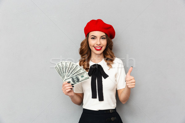 Portré iskolás lány egyenruha tart köteg pénz Stock fotó © deandrobot