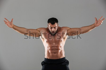 Portrait of a confident strong shirtless male bodybuilder posing Stock photo © deandrobot