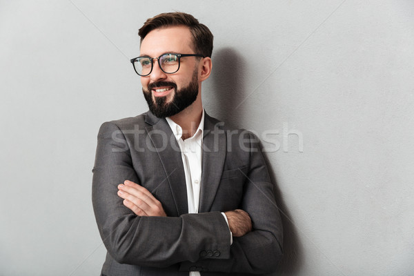 Close up portrait of pleased unshaved man in eyeglasses looking  Stock photo © deandrobot