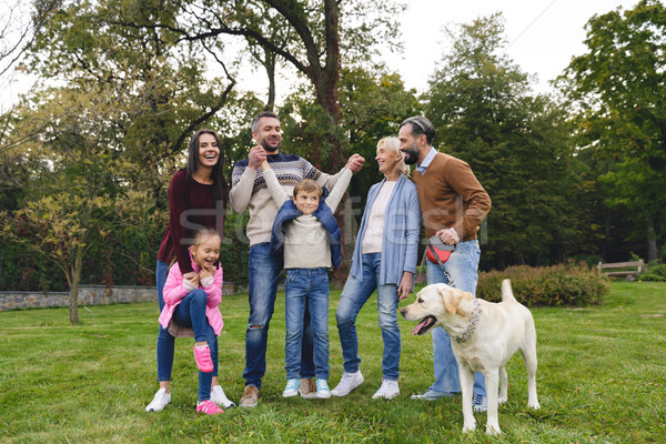 Happy big family with labrador retriever dog spending time Stock photo © deandrobot