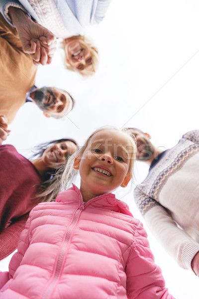 Bottom view of a big smiling family standing outdoors Stock photo © deandrobot