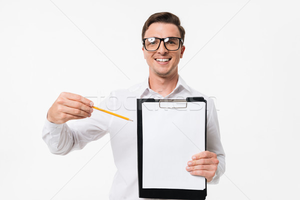 Portrait of a happy smart guy in white shirt Stock photo © deandrobot