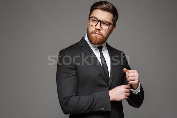 Portrait of a confident young businessman dressed in suit Stock photo © deandrobot