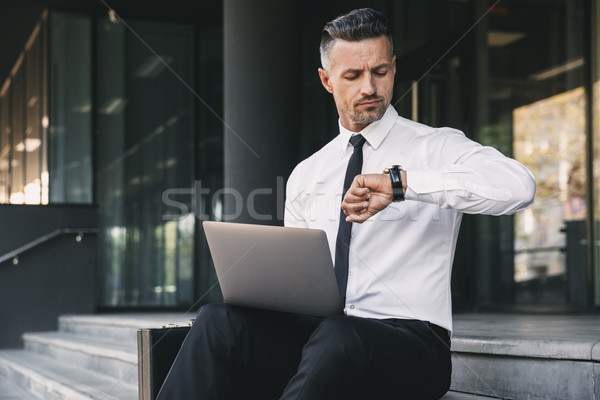 Portrait of a focused young businessman Stock photo © deandrobot