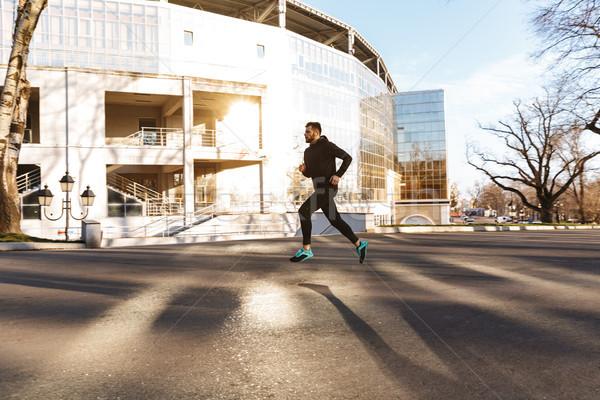Portret jonge jogging buitenshuis Stockfoto © deandrobot