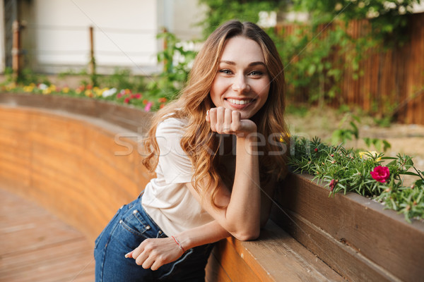 Smiling young girl in casual clothes looking at camera Stock photo © deandrobot