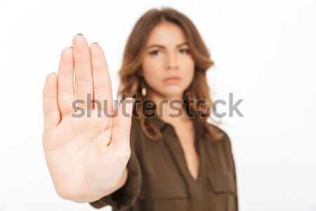 Portrait of a serious young woman showing stop gesture Stock photo © deandrobot