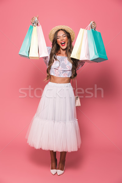 Full length image of joyful woman 20s wearing straw hat and fluf Stock photo © deandrobot