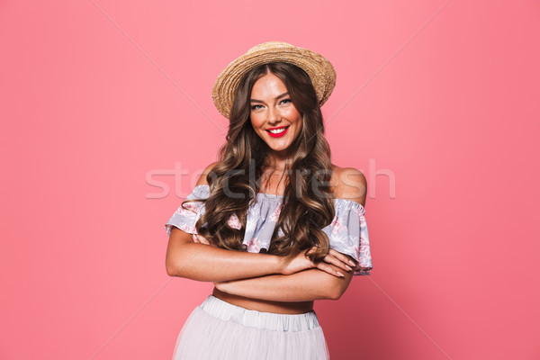 Portrait of adorable glamour woman 20s wearing straw hat smiling Stock photo © deandrobot