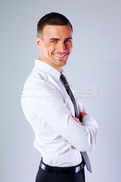 Portrait souriant affaires bras pliées gris Photo stock © deandrobot