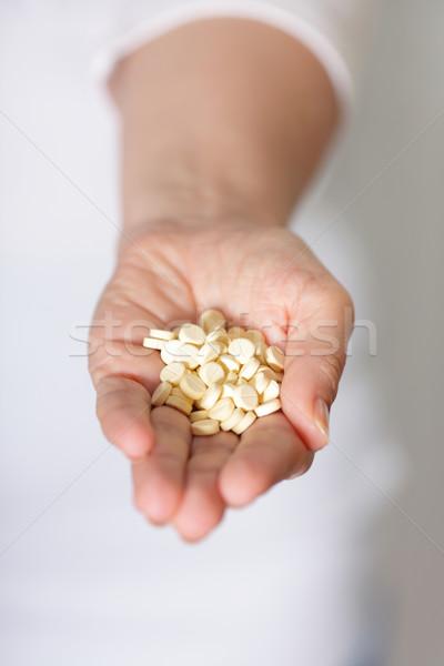 Pilules santé fond bleu aider bouteille Photo stock © deandrobot