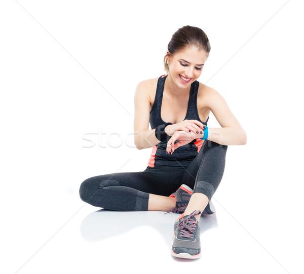 Sporty woman using smart watch Stock photo © deandrobot