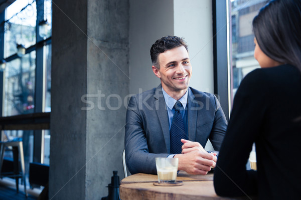 Businesswoman and businessman discussing Stock photo © deandrobot