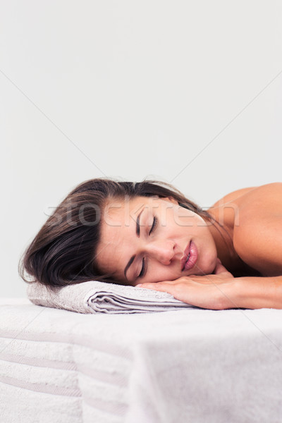 Beautiful woman sleeping on massage lounger Stock photo © deandrobot