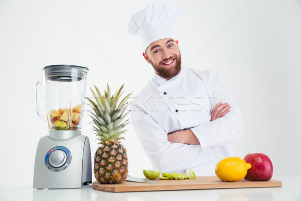 Happy chef cook standing with arms folded  Stock photo © deandrobot