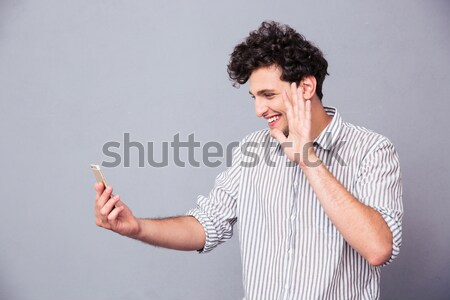 Afro american man with curly hair pointing finger at camera Stock photo © deandrobot