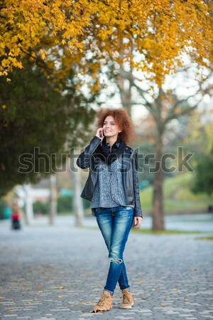 Woman waiting somebody and looking on wrist watch outdoors Stock photo © deandrobot
