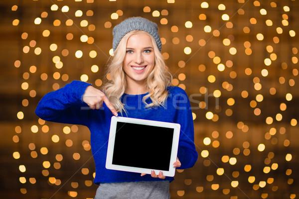 Gülümseyen kadın parmak ekran portre Stok fotoğraf © deandrobot