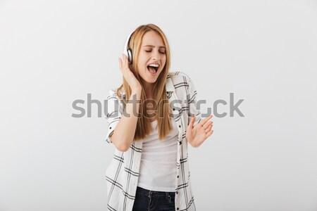 Opgewonden populair jonge mannelijke zanger Stockfoto © deandrobot