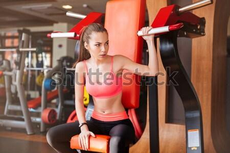 Fuerte mujer atleta gimnasio hermosa Foto stock © deandrobot