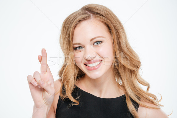 Beautiful woman standing with crossed fingers Stock photo © deandrobot