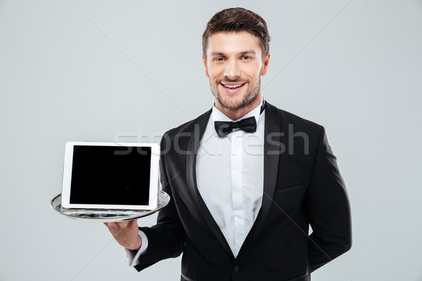 Vrolijk De ober smoking scherm tablet Stockfoto © deandrobot