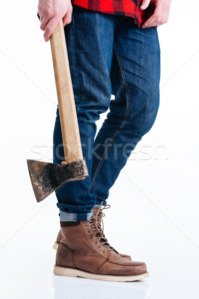 Cropped image of male legs and hands holding axe Stock photo © deandrobot