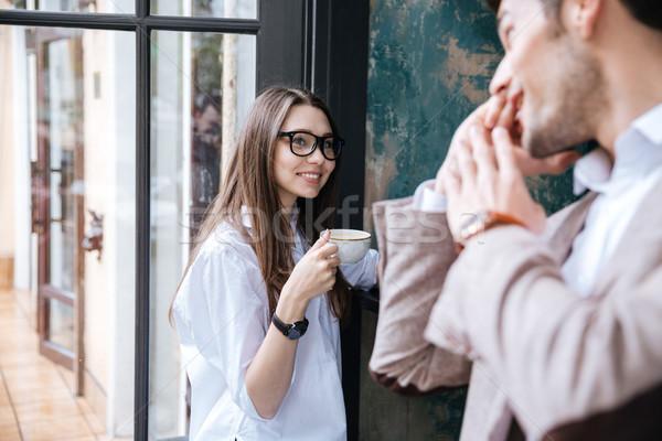 Jonge knap zakenman telefoongesprek cafe Stockfoto © deandrobot