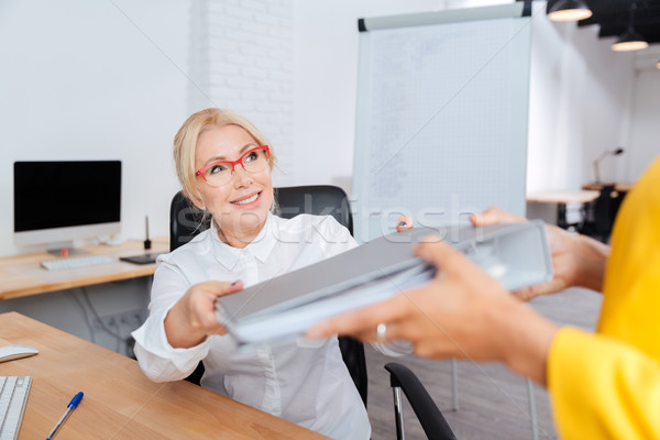 Two businesswomen cooperating in the office Stock photo © deandrobot
