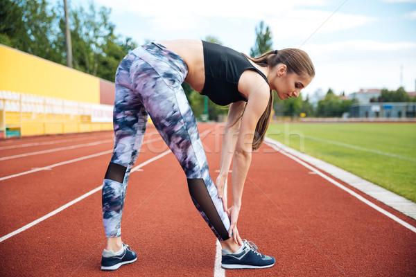 Spor kadın egzersiz stadyum güzel Stok fotoğraf © deandrobot