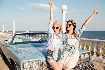Alegre moço duas mulheres em pé as mãos levantadas vintage Foto stock © deandrobot