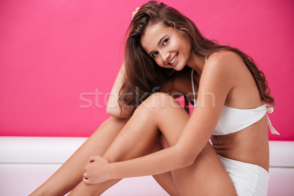 Close up portrait of a happy girl in white swimsuit Stock photo © deandrobot