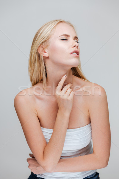 Portrait of a charming seductive woman wearing top Stock photo © deandrobot