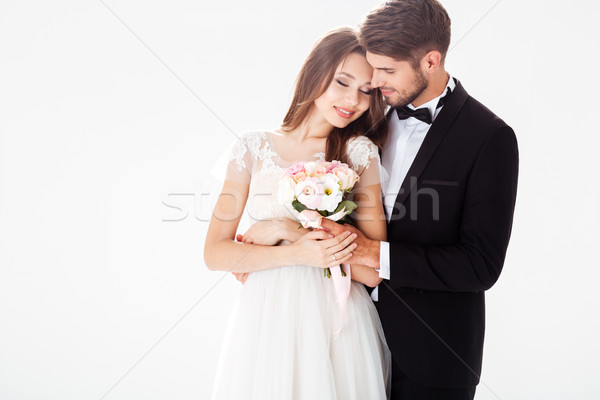 Portrait of smiling newlyweds Stock photo © deandrobot