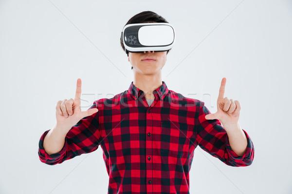 Asian homme réalité appareil Photo stock © deandrobot