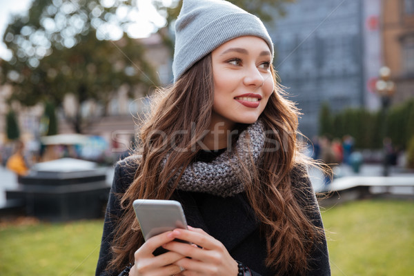Smiling woman in coat Stock photo © deandrobot