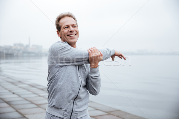Runner warming up near the water Stock photo © deandrobot