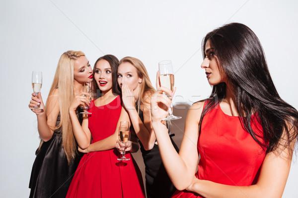 Mosolyog fiatal nők iszik pezsgő pletykál buli Stock fotó © deandrobot