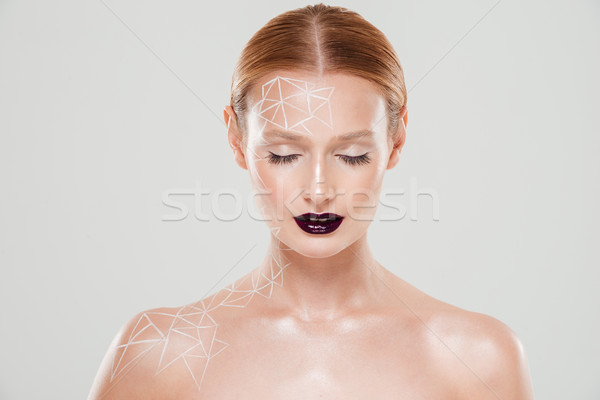 Beauty image of girl with body art and eyes closing Stock photo © deandrobot