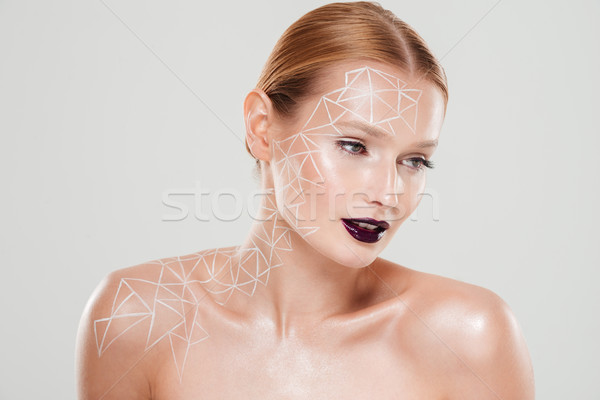Beauty image of pretty girl with body art Stock photo © deandrobot