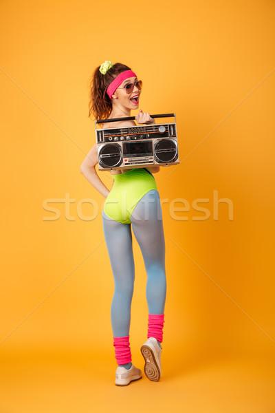 Mosolyog fiatal fitnessz nő tart retro néz Stock fotó © deandrobot