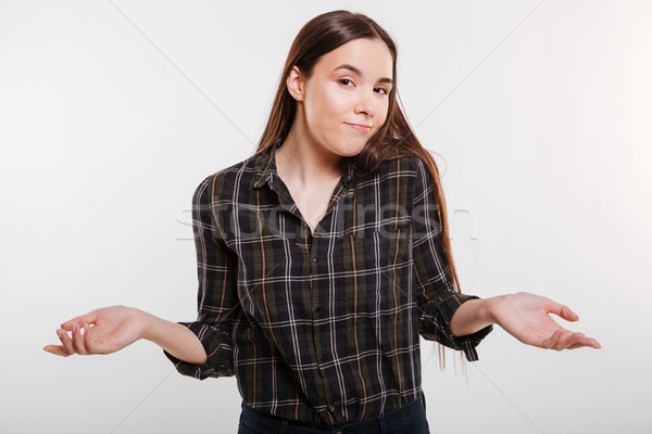 Woman in shirt does not understand Stock photo © deandrobot