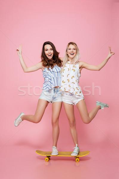 два счастливым женщины Постоянный скейтборде Сток-фото © deandrobot