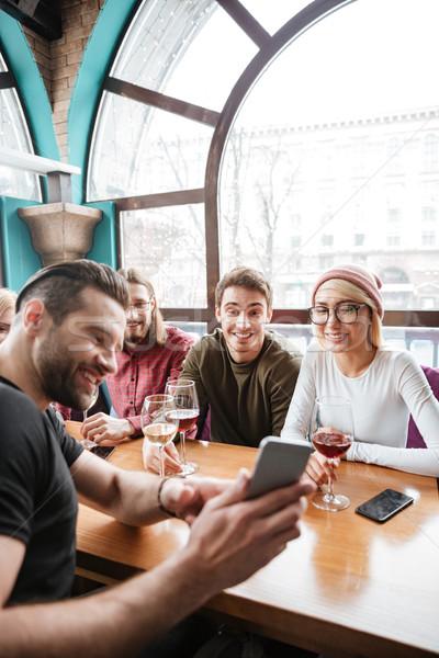 Boldog barátok kávézó iszik alkohol gyártmány Stock fotó © deandrobot