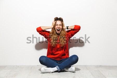 Hideg hipszter póló ül pózol stúdió Stock fotó © deandrobot