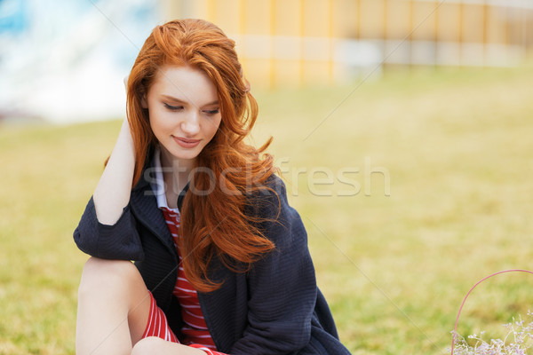 Attractive young red head woman with long hair in park Stock photo © deandrobot