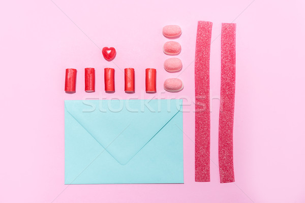 Candies and lollies in a row with blank paper envelope Stock photo © deandrobot