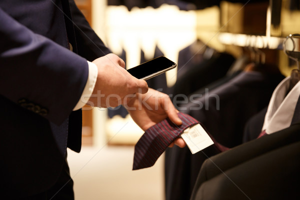 Side view  of man making photo of price-list Stock photo © deandrobot
